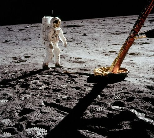 Buzz Aldrin walking the candying gear of the LM